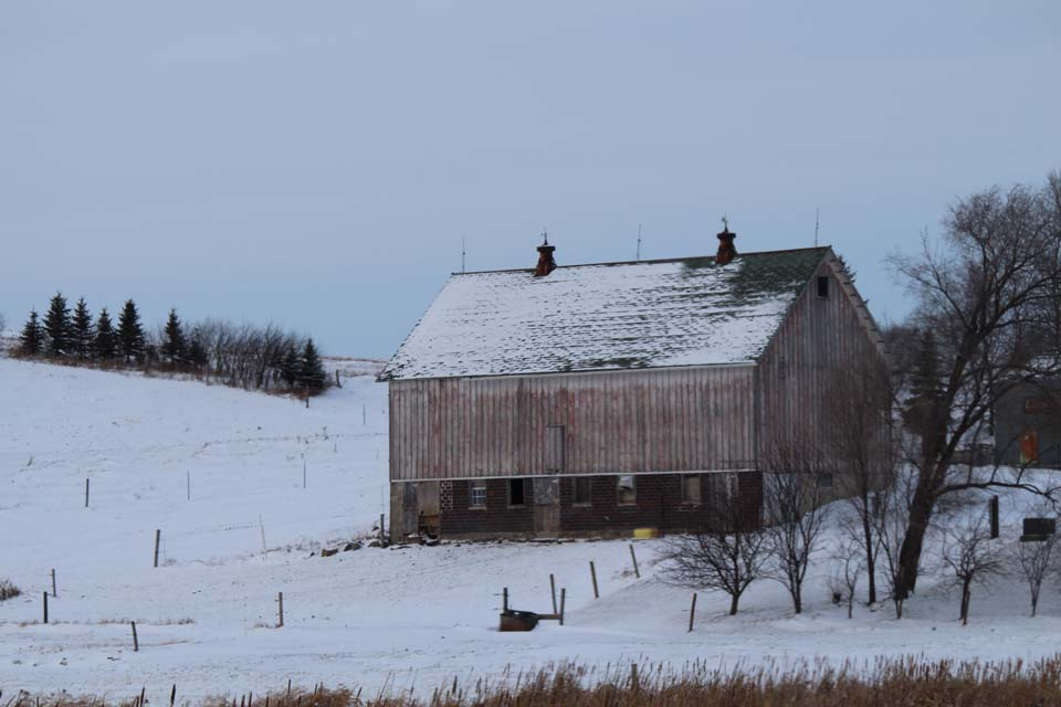 snow covered rustic barn